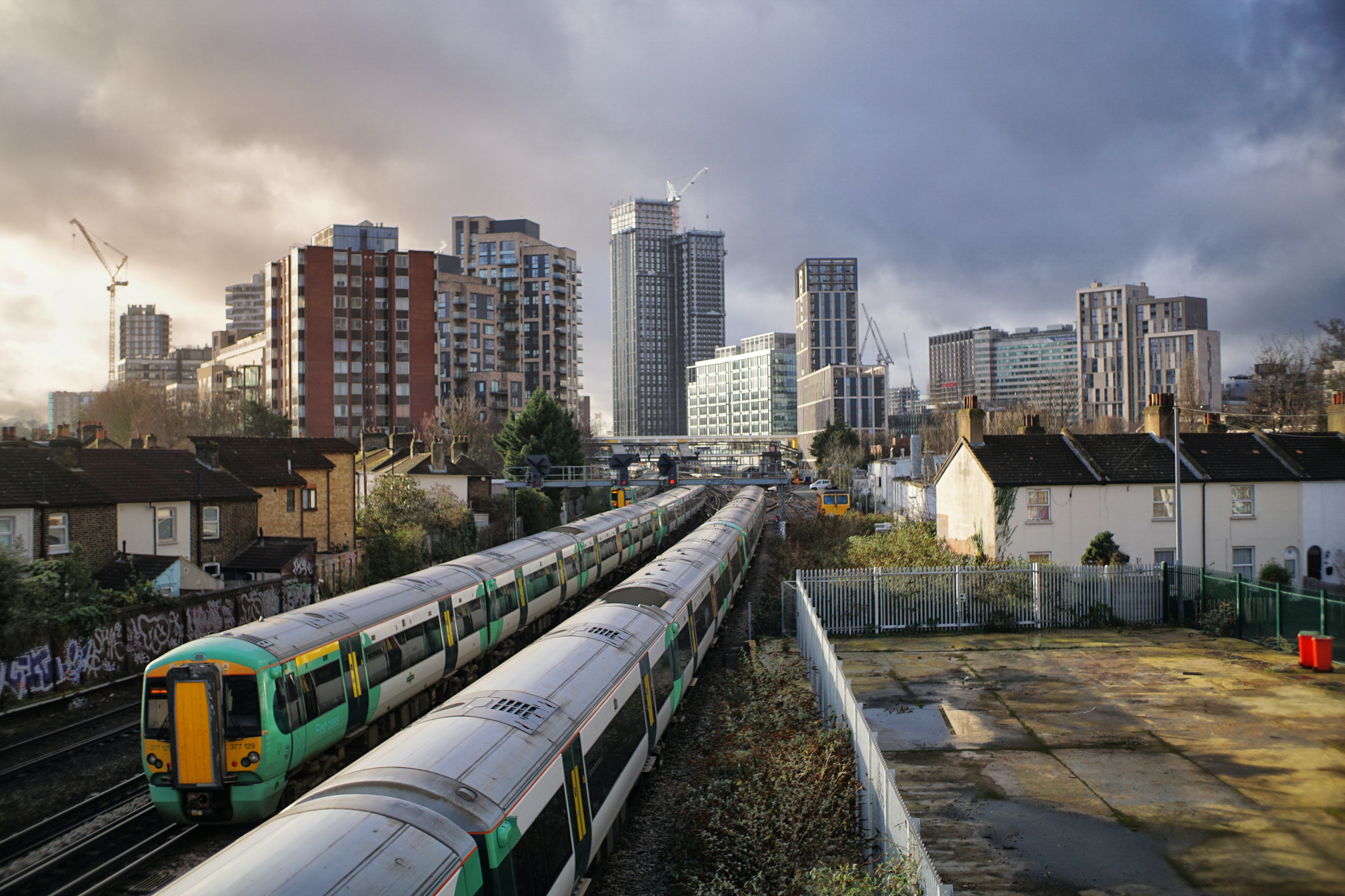 Train with highrise buildings in the background -South East London