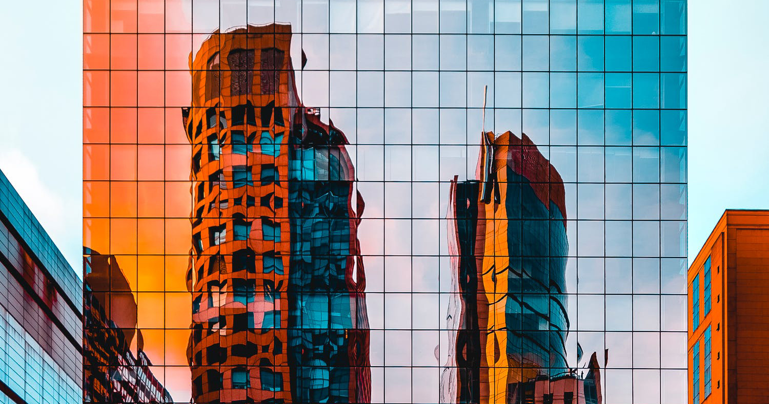 Yellow buildings reflected in mirrored windows