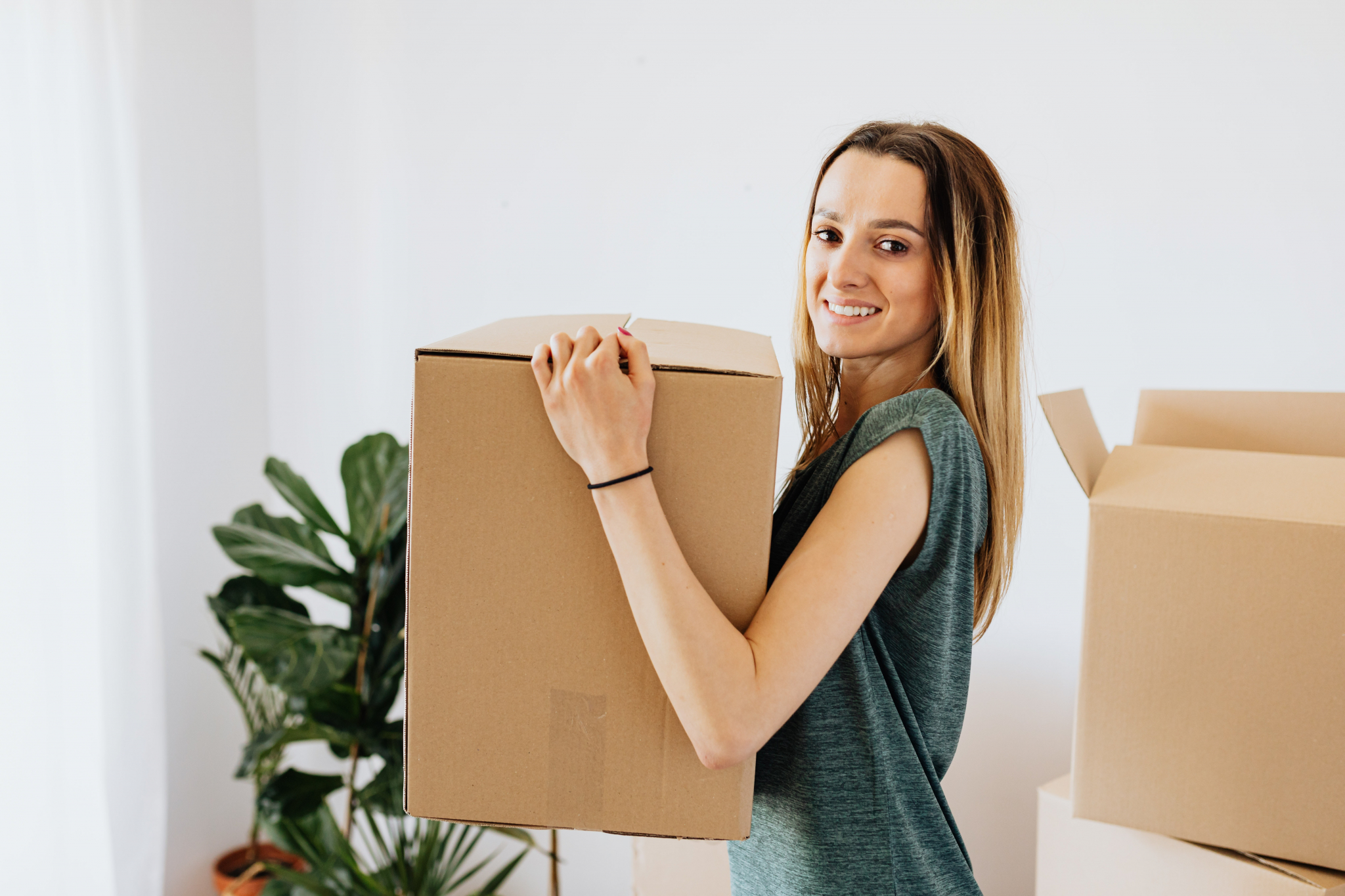 Removal costs UK - woman moving house