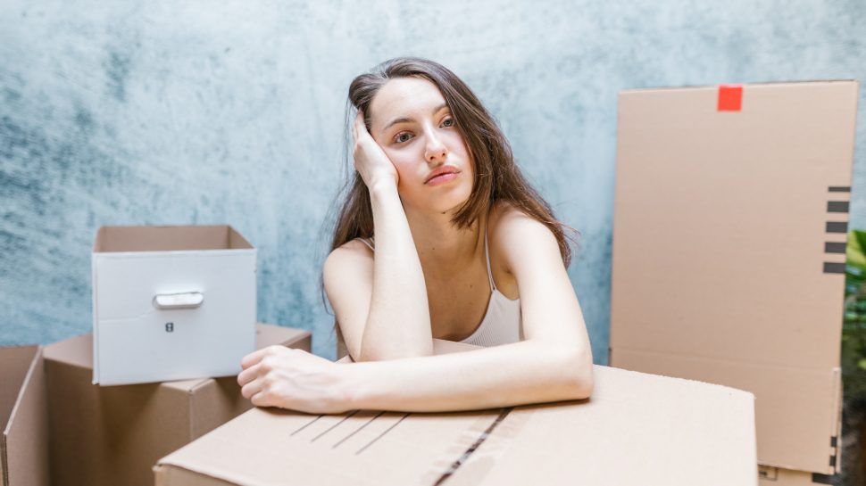 Woman with packing boxes.